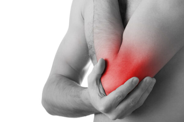 sore red elbow pain due to tennis elbow