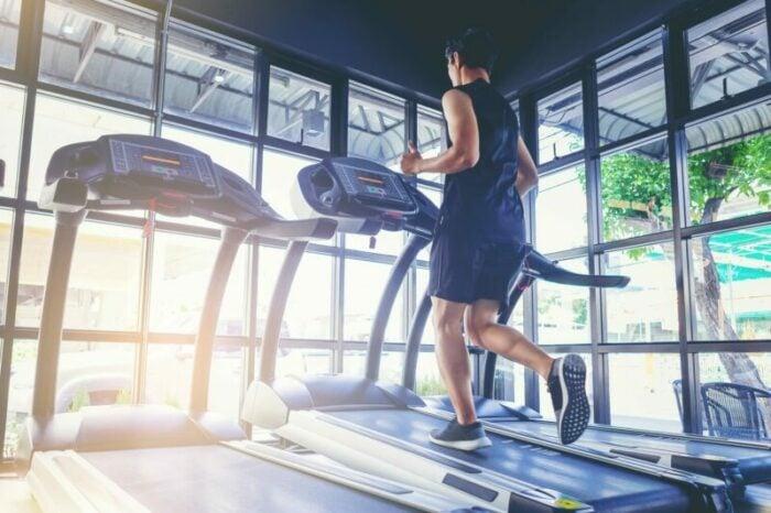 Man running on a treadmill at a gym