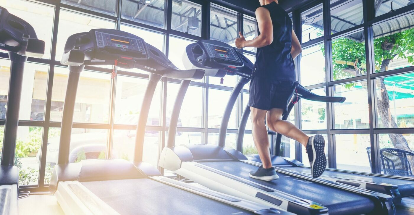 Man running on a treadmill at a gym