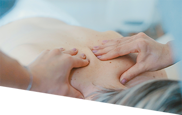 Close up of hands massaging a patient's lower neck