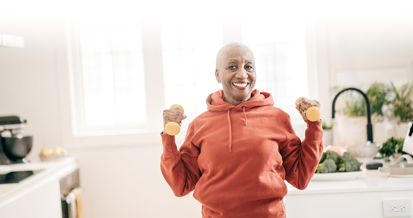 Happy woman performing physiotherapy exercises