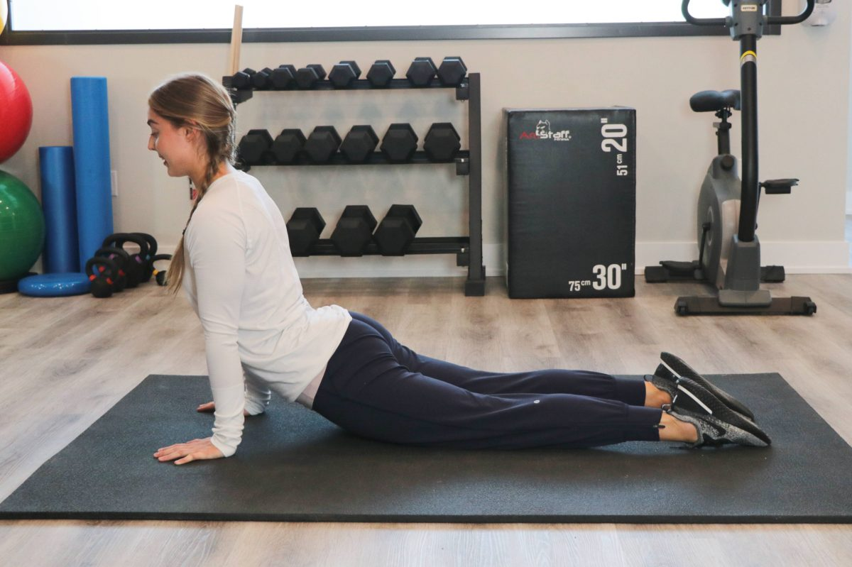 Woman demonstrating upward dog position at Cornerstone Physiotherapy in Burlington
