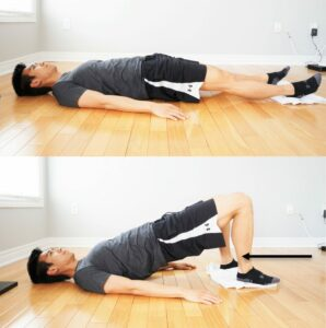 man performing a bridge exercise while his feet are pulling a towel toward him