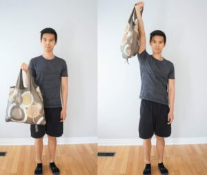 man using a grocery bag to curl up and lift overhead with one arm