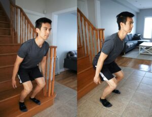 man performing a box jump from the bottom stair to the floor