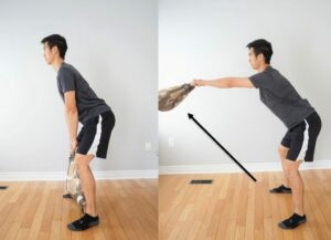man performing a kettle bell swing exercise using a heavy grocery bag