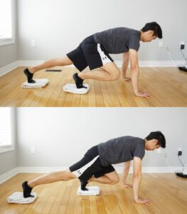 man performing an exercise on hands and feet with feet on towels
