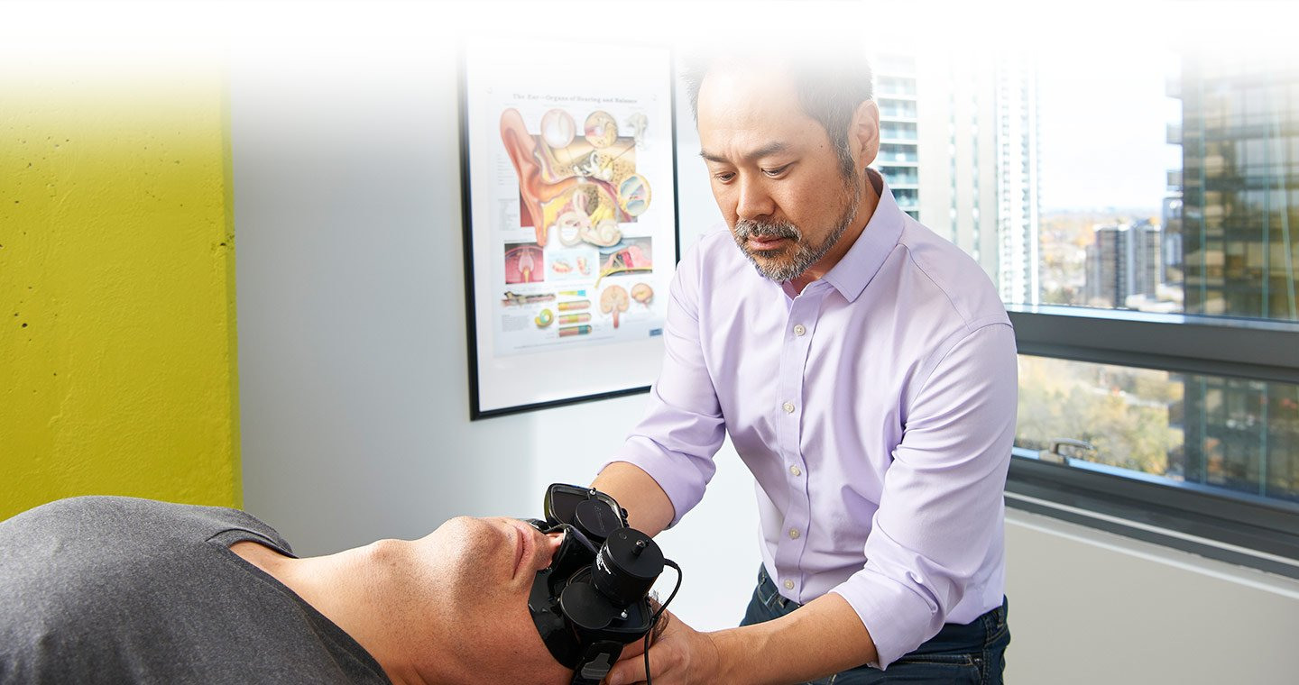 Physiotherapist Joon Nah performing vestibular diagnostic testing