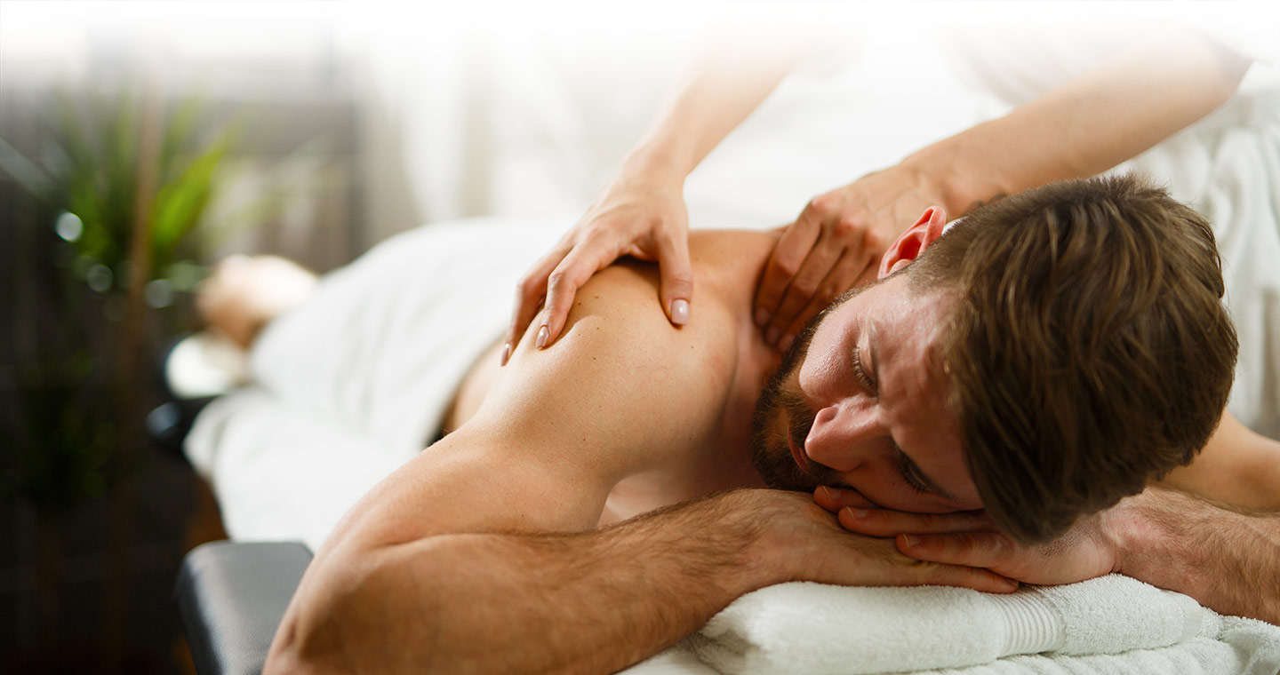 Man receiving Massage Therapy to his right shoulder