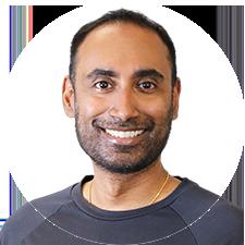 Headshot of Toronto Registered Massage Therapist Mayooran Mylvaganam