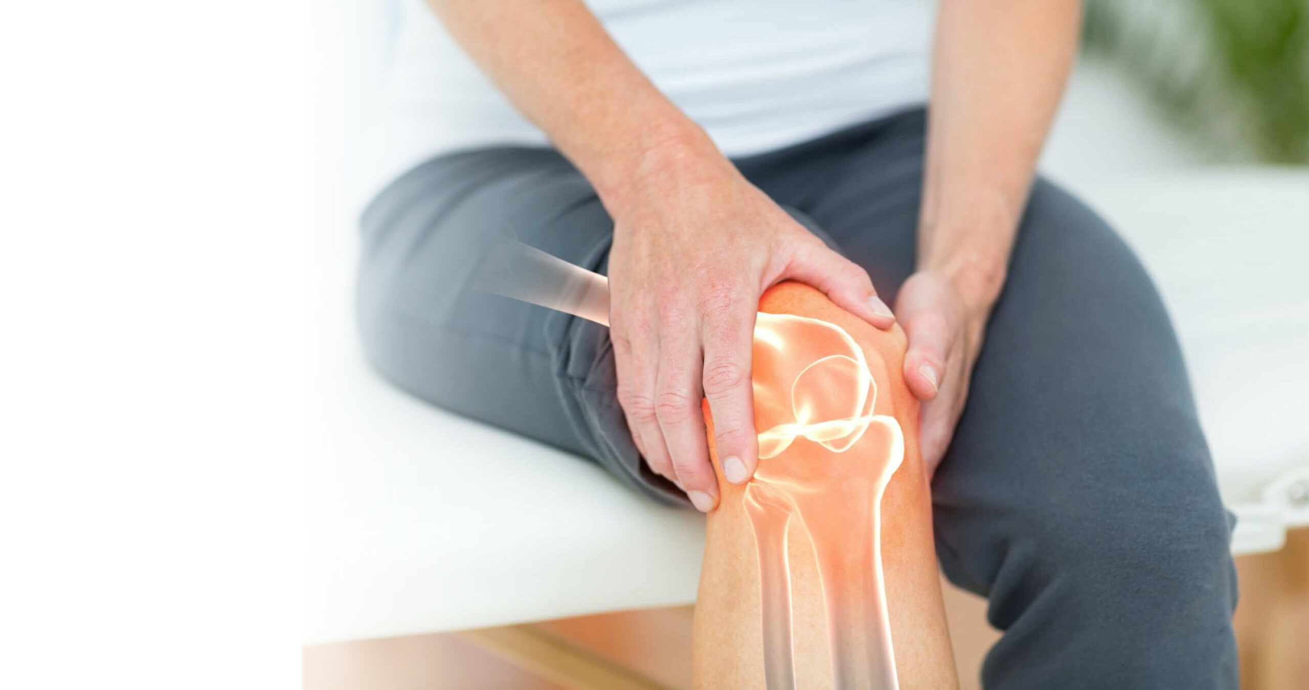 woman holding knee in pain due to osteoarthritis or arthritis