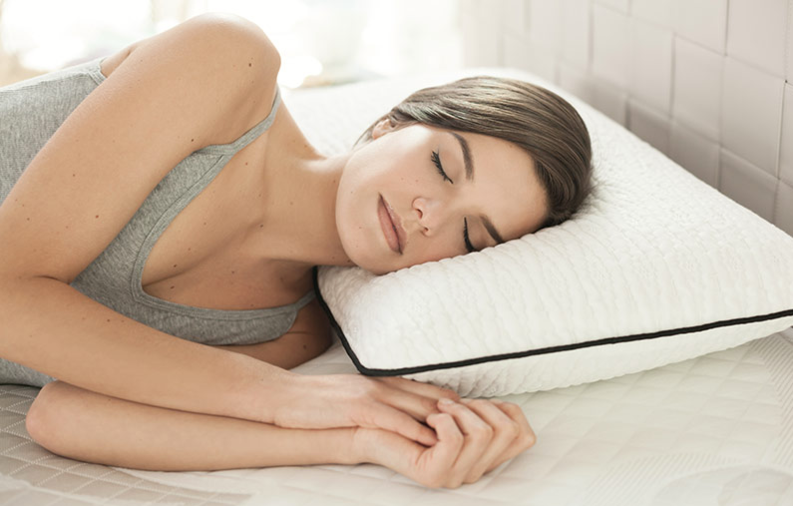 woman sleeping on best pillow for side sleepers